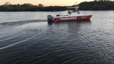 Trawler being towed by TowBoat U.S.