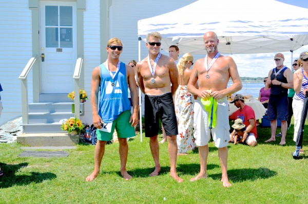 Awards ceremony at the foot of the lighthouse at the Rose Island Battle Of The Bay Paddle Race